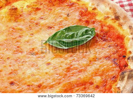Basil Leaf Over The Italian Pizza In A Pizzeria In Naples