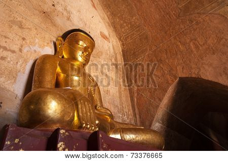 Ancient Architecture Of Old Buddhist Temples At Bagan Kingdom, Myanmar (burma). Golden Buddha Statue