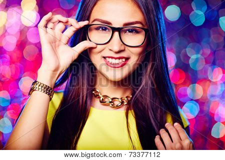 Glamorous girl in glasses