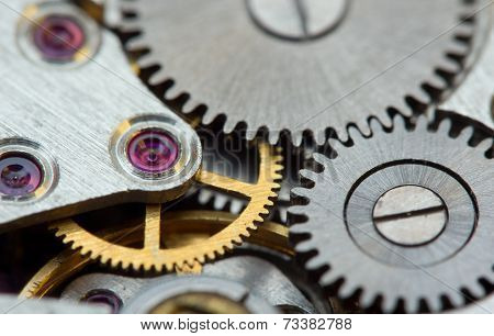 Technological background with metal cogwheels a clockwork.