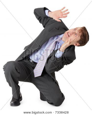 Frightened Businessman Sitting On White Background