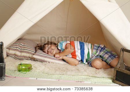 Child Taking A Nap In A Teepee Tent