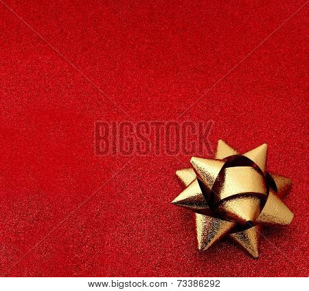 Red glitter background gold bow