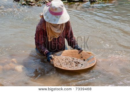 Woman Washing Gold In River