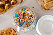 pic of bonbon  - Multicolor bonbon sweets in a jar on a dessert table at party or wedding celebration - JPG