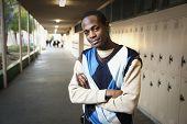 foto of attitude boy  - African teenage boy standing in school hallway - JPG