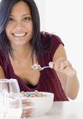 pic of pacific islander ethnicity  - Pacific Islander woman eating cereal - JPG
