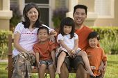 foto of sitting a bench  - Asian family sitting on bench - JPG