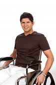 foto of physically handicapped  - Successful disabled man sits in his wheelchair smiling - JPG