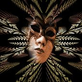 stock photo of divergent  - Surreal carnival mask and fractal pattern of the leaves as divergent rays - JPG
