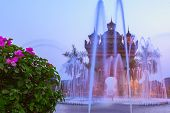 pic of fountains  - Sunset view of Patuxai arch or Victory Triumph Gate monument with fountain in front - JPG