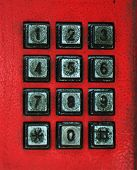 foto of dial pad  - A red phone with a black key pad - JPG
