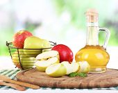 pic of vinegar  - Apple cider vinegar in glass bottle and ripe fresh apples - JPG