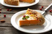 picture of pumpkin pie  - Homemade pumpkin pie on table - JPG