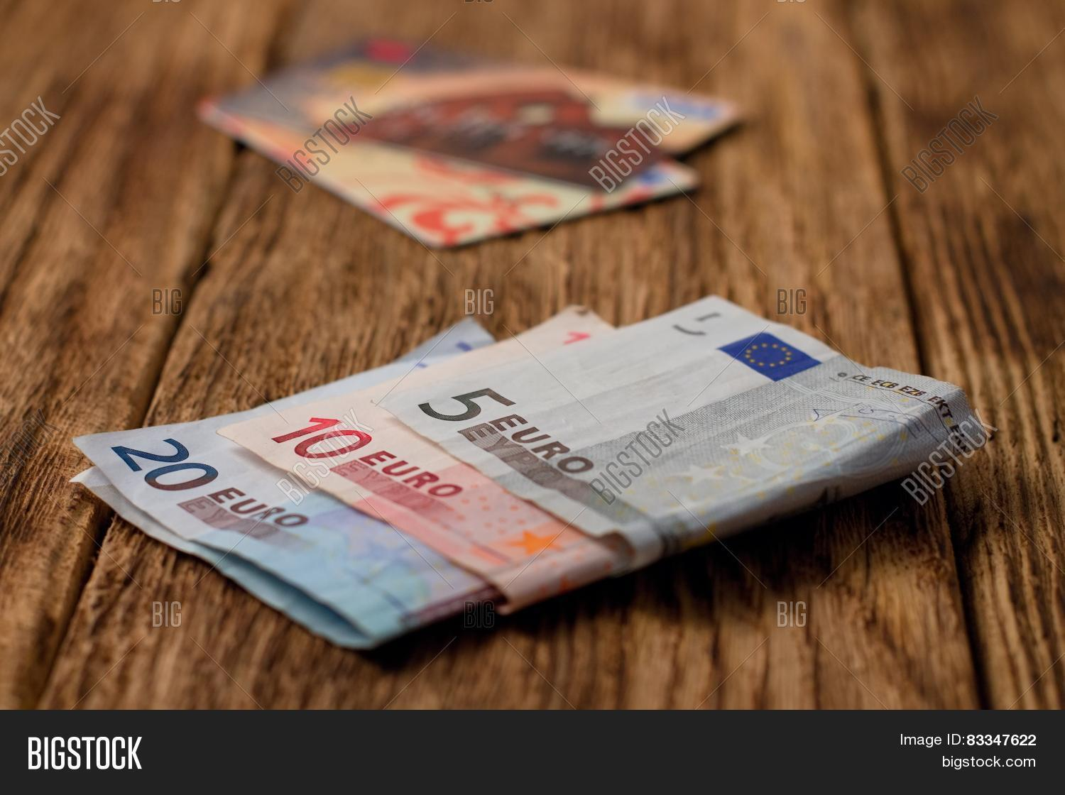 euro bills on wooden board with credit cards in background stock photo stock images bigstock. Black Bedroom Furniture Sets. Home Design Ideas