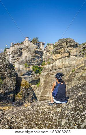Girl looking in the famous monastery Meteora, Greece