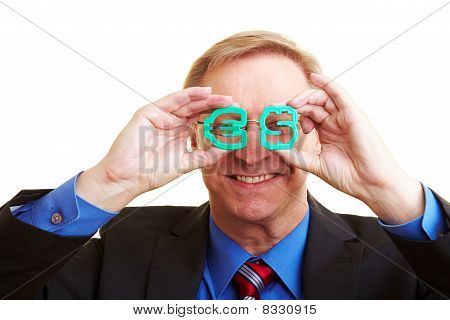 Businessman Looking Through Euro And Dollar