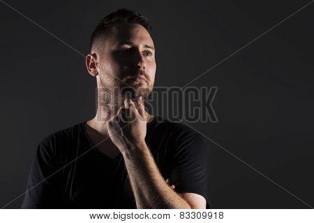 Man posing with dark background
