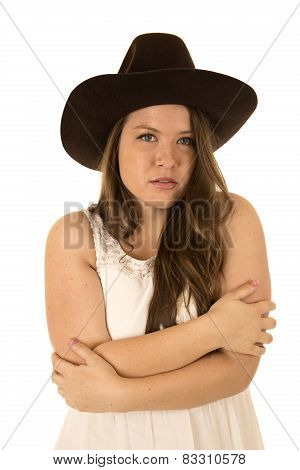 Cowgirl In White Dress With Good Expression And Her Arms Folded