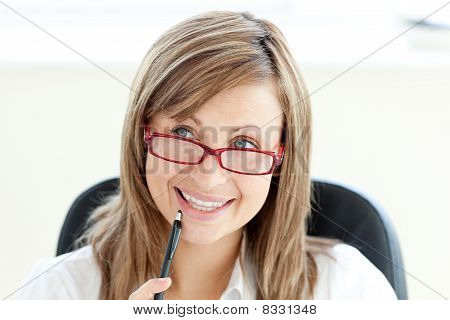 Portrait Of A Delighted Caucasian Businesswoman Sitting On Her Chair