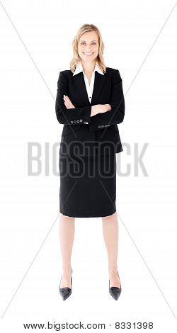 Self-assured Businesswoman With Folded Arms Smiling At The Camera