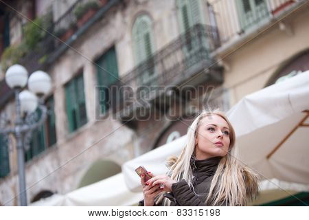 Blonde Young Woman Touring An European City
