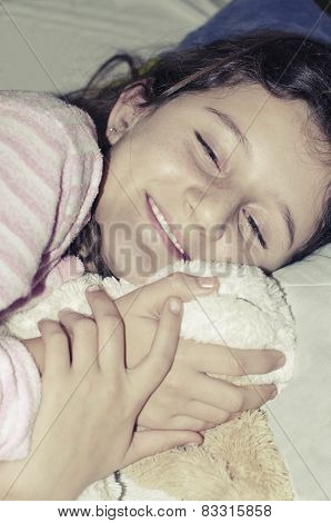 Little girl sleeping with her lovely toy