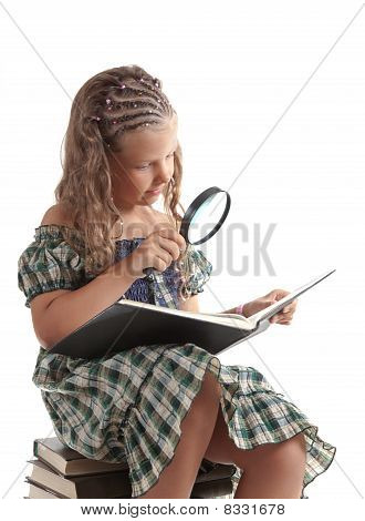 Little Girl Holding Magnifying Glass