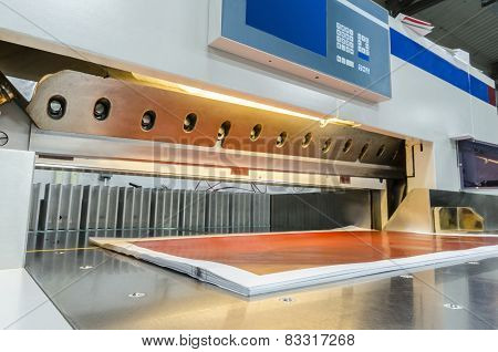 Paper guillotine with touch screen used in commercial printing industry