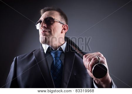 male gangster with glasses and a baseball bat
