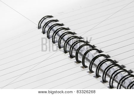 Close Up Of A Spiral Bound Notebook With Black Spirals