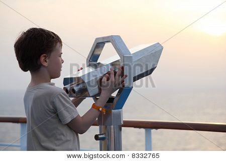 Little Boy Standing Near Binocular And Looking Into The Distance Side View Half Body