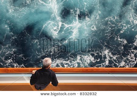 Man Standing At Cruise Ship Deck And Looking At Side View From Above