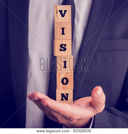 Six Wooden Cubes Spelling The Word Vision