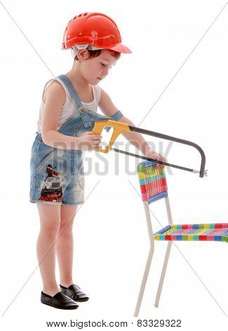 little boy in front of a chair hacksaw.