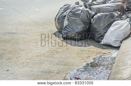 Image Of Black Garbage Bag On The Roadside.