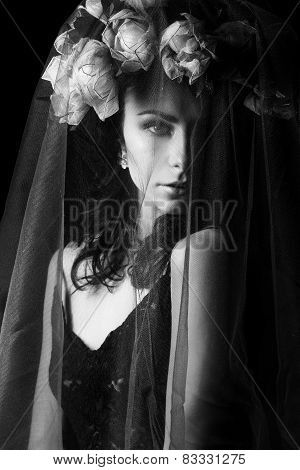 black and white portrait of a beautiful sexy girl with black hair in a black lace dress