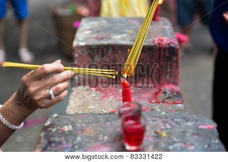Burning joss sticks at pagoda, Saigon, Vietnam