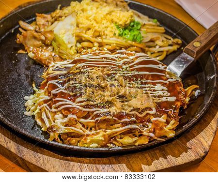 Closeup Cooking Okonomiyaki Or Japan Pizza With Hot Iron Frying Pan