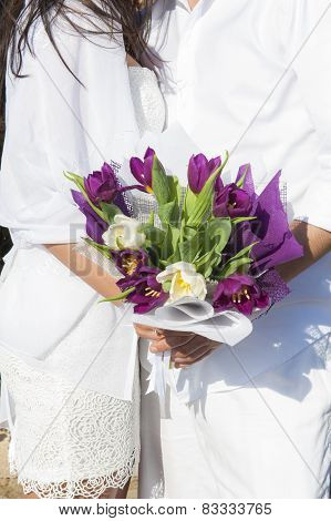 Newly Married Couple Holding Flowers