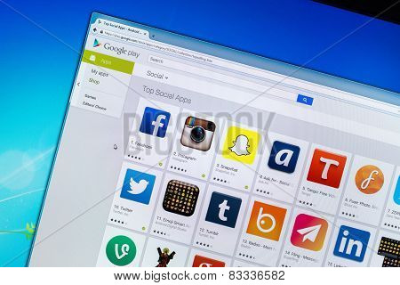 Photo of the Google Play Store on a monitor screen, showing the top social apps.