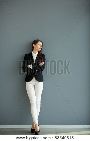 Young Bussiness Woman By The Wall