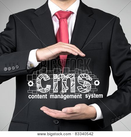 Businessman Holding Cms Symbol