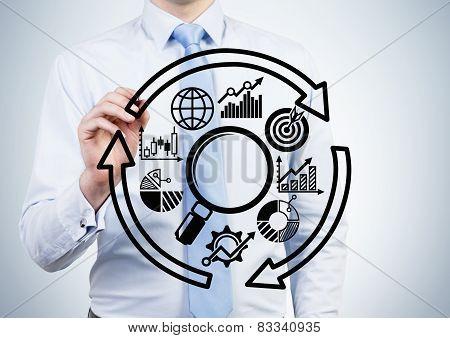 Businessman Drawing Schem