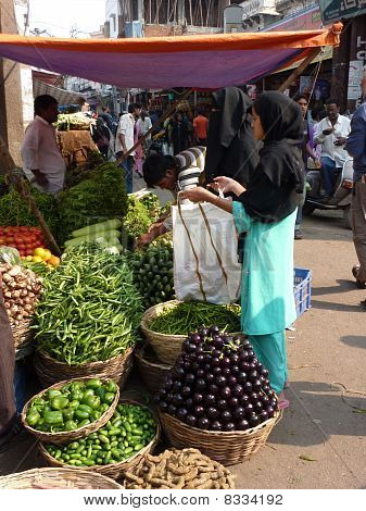 Veiled Muslim Women Shop For Food