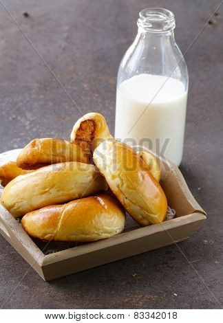 homemade pastries, sweet buns rolls with milk