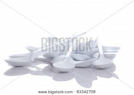 White Plastic Spoons Isolated On White Background