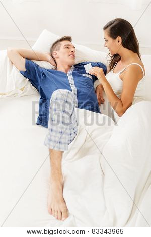 Young Couple With Condom