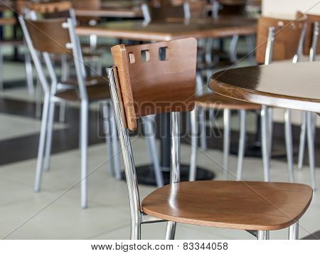 Tables and chairs in cafe in the food court of shopping center
