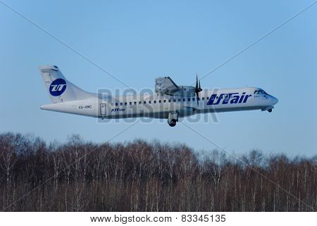 NIZHNY NOVGOROD. RUSSIA. FEBRUARY 17, 2015. The ATR-72 plane of the Utair company flies up.